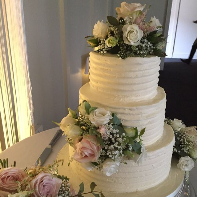 wedding cake with flowers on the side cake flowers junie s florist gravesend kent 26884